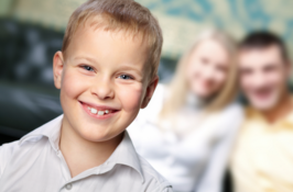 boy smiling in front of parents